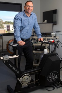 UCRISE Director Professor Kevin Thompson and cycle ergometer in physiology lab