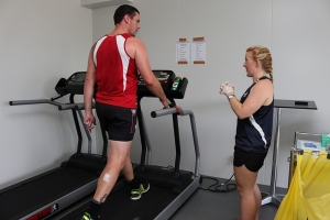 AFC player Damian Bowles trains in the Environmental Chamber, supervised by PhD Candidate Rachel Gale.